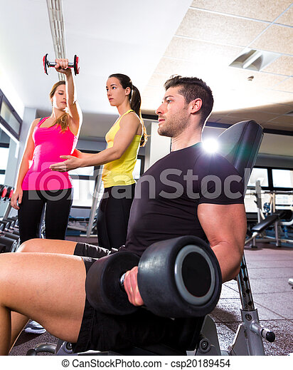 Dumbbell man at gym workout fitness weightlifting - csp20189454