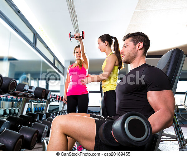 Dumbbell man at gym workout fitness weightlifting - csp20189455