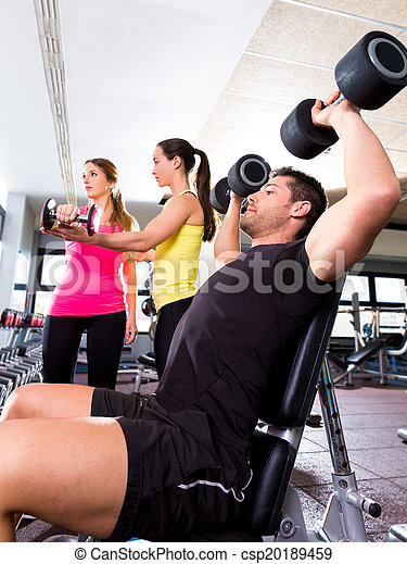 Dumbbell man at gym workout fitness weightlifting - csp20189459