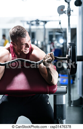 Dumbbell training in gym - csp31476378