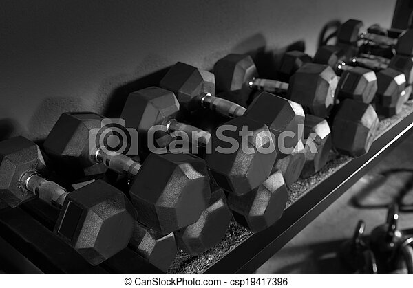 Dumbbells and Kettlebells weight training gym - csp19417396