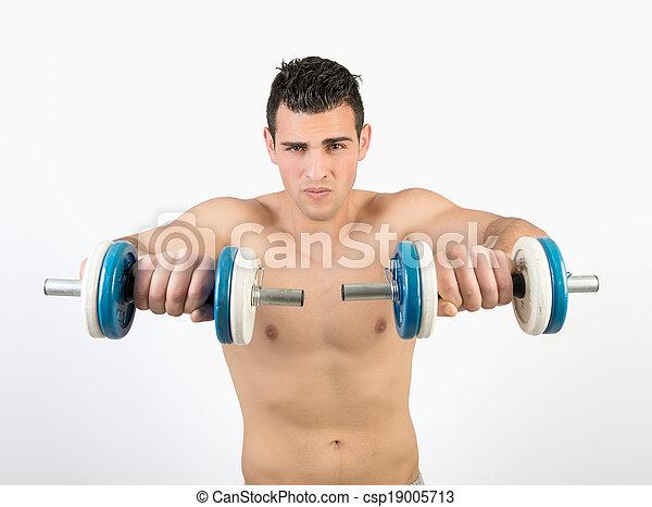 Un joven musculoso con pesas - csp19005713