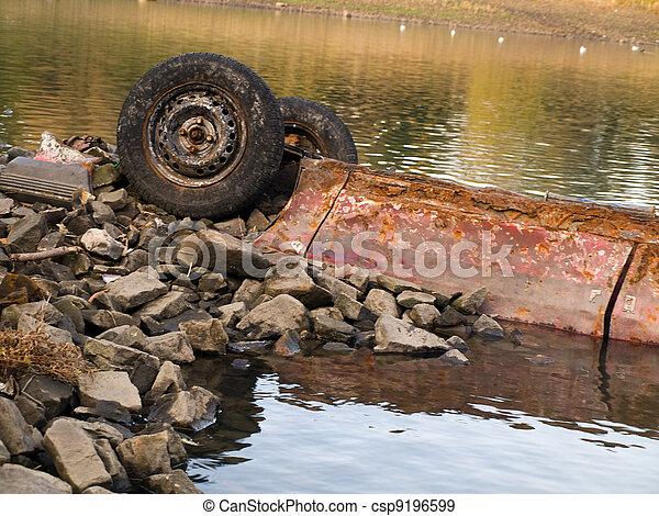 Dumped Rusting Car Polluting Lake - csp9196599