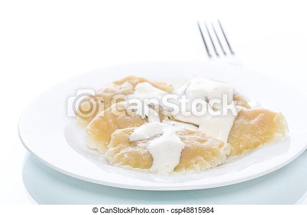 Dumplings stuffed with sour cream boiled - csp48815984