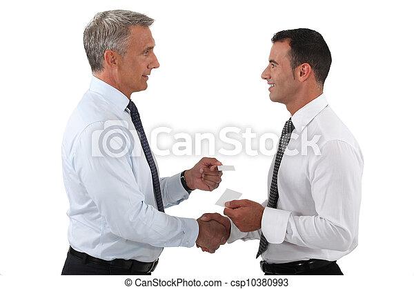 duo of businessmen exchanging visit cards - csp10380993