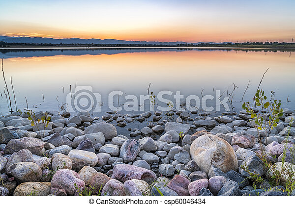 Dusk over a lake in Colorado foothills - csp60046434