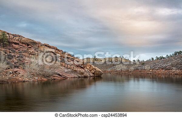 dusk over mountain lake - csp24453894