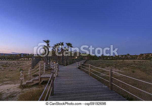 Dusk view in walkway to Salgados beach in Albufeira, Algarve. - csp59192698