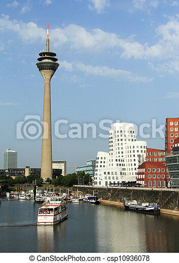 DUSSELDORF, GERMANY - JUNE 19: Media Harbor on June 19, 2012 in Dusseldorf, Germany. The Media Harbor is the most popular destination for architectural tourism in the city. - csp10936078
