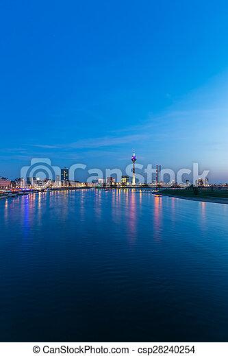 Dusseldorf skyline at blue hour night at the rhine river - csp28240254