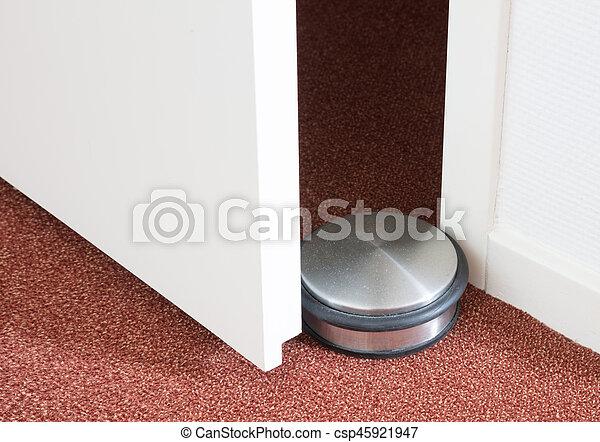 Dusty doorstop in a modern house - csp45921947