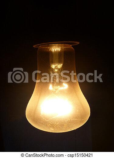 Dusty light bulb on dark background - csp15150421