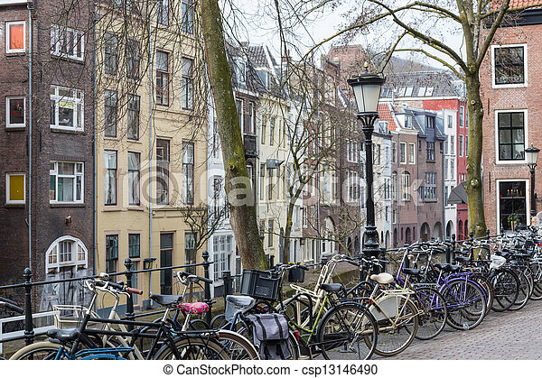 Dutch city Utrecht with bicycles and old historic houses - csp13146490