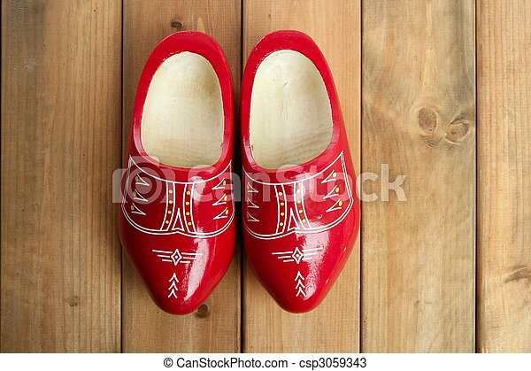 Dutch Holland red wooden shoes on wood - csp3059343