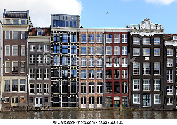 dutch medieval buildings on canal in Amsterdam - csp37560105