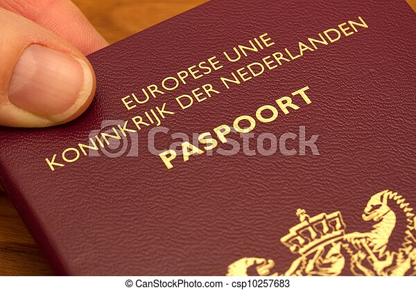 Pictures of dutch passport hand holding a dutch passport dutch passport csp10257683 ccuart Choice Image