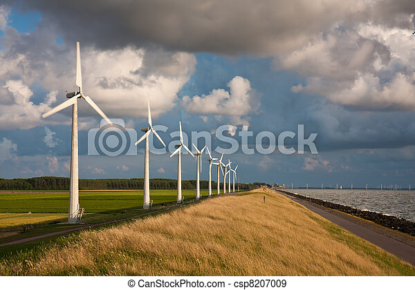 Dutch Windturbines and a cloudscape in the last sunlight of a summer evening - csp8207009
