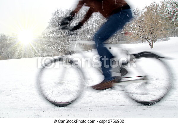 Dynamic cyclist with motion blur and winter sun - csp12756982