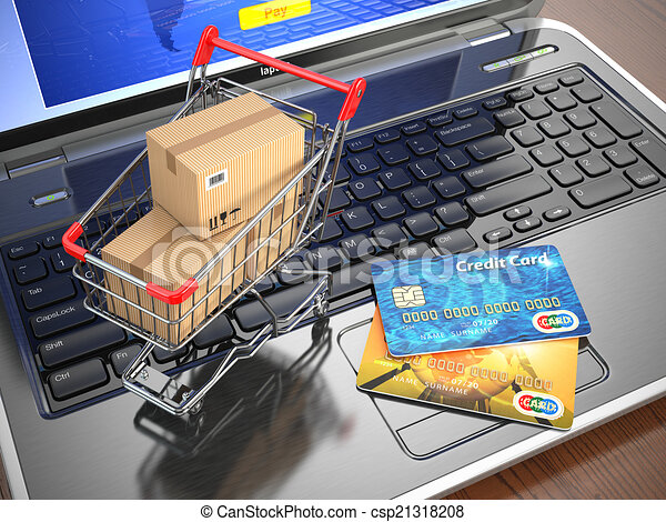 E-commerce. Shopping cart and credit cards on laptop. - csp21318208
