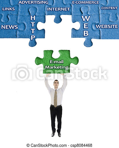 E-mail Marketing word on puzzle in man hands - csp8084468