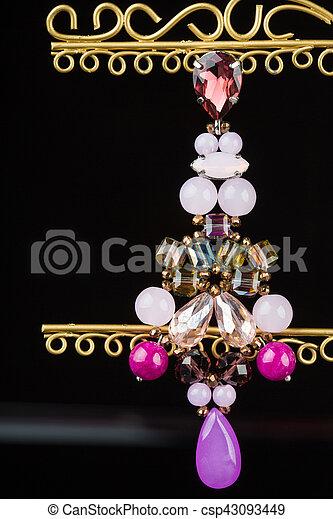 earrings on black - csp43093449
