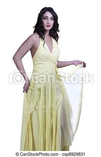 East Indian Teen Woman Standing Yellow Dress - csp8929831