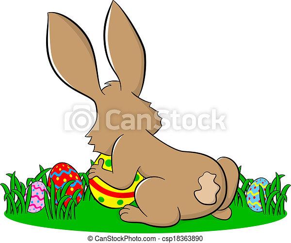 easter bunny hiding eggs - csp18363890