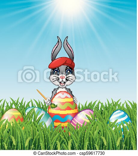 Easter bunny painting Easter eggs - csp59617730