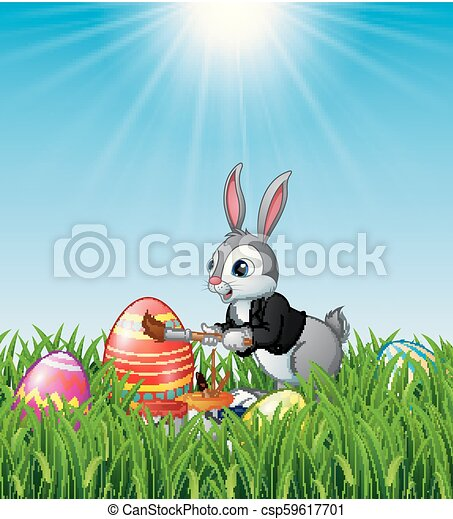 Easter bunny painting Easter eggs - csp59617701