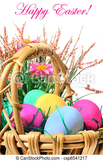 Easter colored eggs in the basket on the white background  - csp6541217