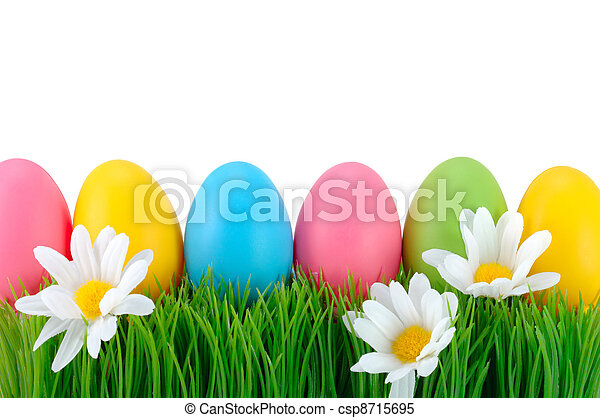 Easter colored eggs on the grass.  - csp8715695