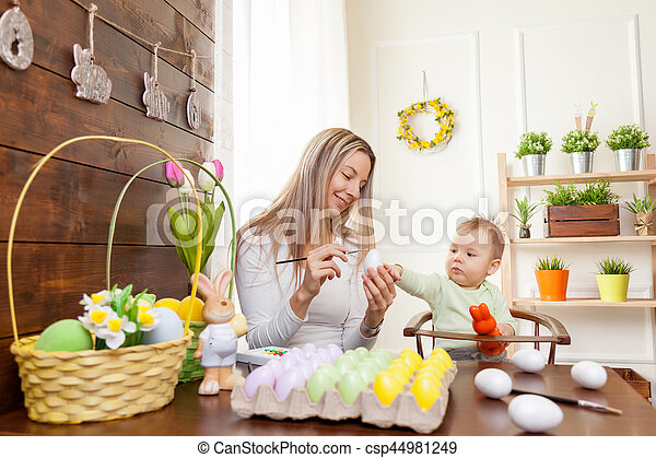 Easter concept. Happy mother and her cute child getting ready for Easter - csp44981249