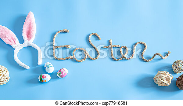 Easter creative inscription on a blue background. - csp77918581