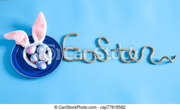 Easter creative inscription on a blue background. - csp77918582