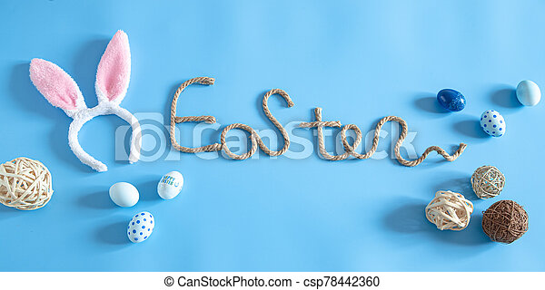 Easter creative inscription on a blue background. - csp78442360