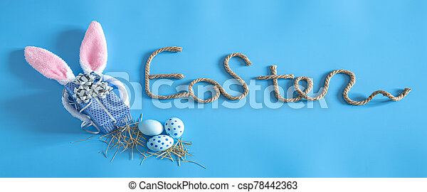 Easter creative inscription on a blue background. - csp78442363