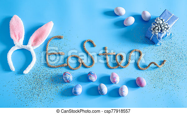 Easter creative inscription on a blue background. - csp77918557