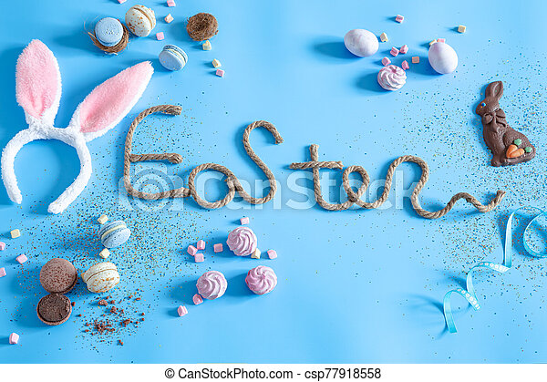 Easter creative inscription on a blue background. - csp77918558