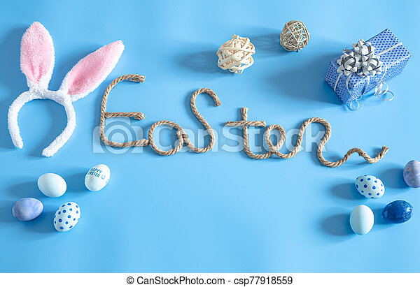 Easter creative inscription on a blue background. - csp77918559