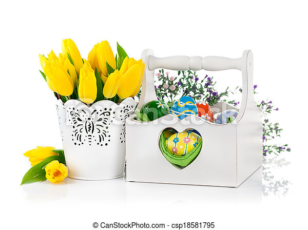 Easter eggs in basket with spring flowers - csp18581795