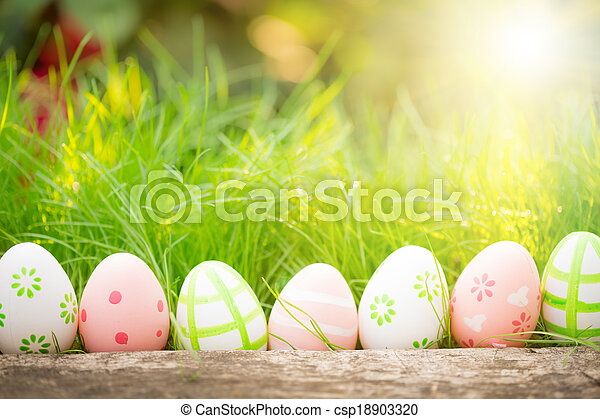 Easter eggs on green grass - csp18903320