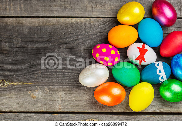 Easter eggs on wooden background - csp26099472