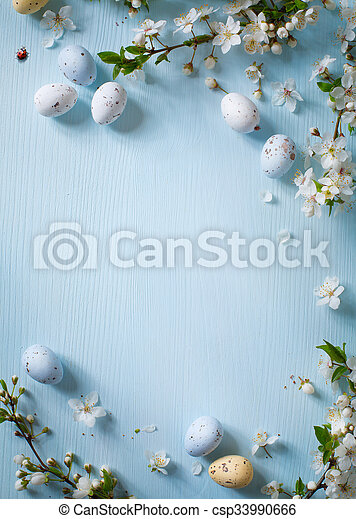 Easter eggs on wooden background - csp33990666