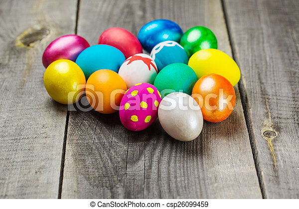 Easter eggs on wooden background - csp26099459