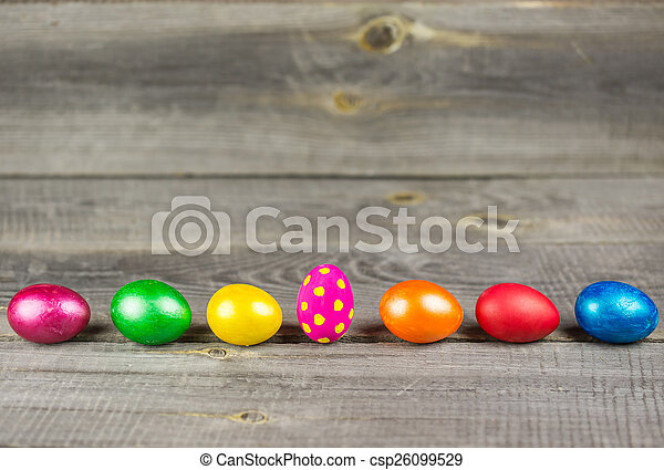 Easter eggs on wooden background - csp26099529