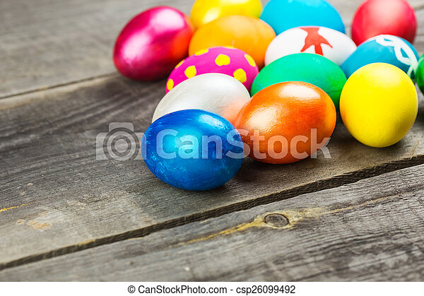 Easter eggs on wooden background - csp26099492