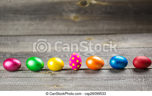 Easter eggs on wooden background - csp26099533