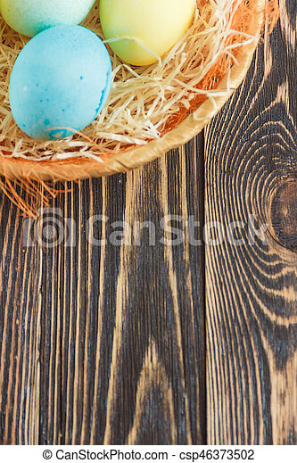 Easter eggs on wooden background with copyspace - csp46373502