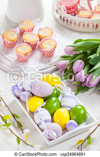 Easter place setting with painted eggs - csp34964691