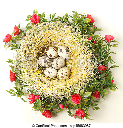 Easter quail eggs in the nest - csp45683987